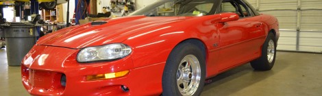 9 second Red Chevrolet Camaro